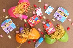 This blogger tackled a question I often have: how to turn traditional candy-filled holiday traditions into candy-less occasions. Mini-Uno and Mini-Mad Libs, markers, etc. Great idea for Easter egg hunt!