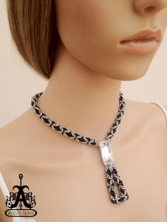 Contemporary Chain Maille Necklace with a Large Swarovski Crystal Centerpiece. $65.00, via Etsy.