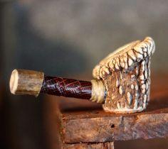 Deer antler and snakeskin pipe.