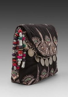 Nice mix of beads, coins and decoration on this little bag