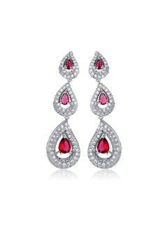 *Free shipping worldwide* Three graduated-size pear-shaped brilliant cut synthetic rubies are set in prongs that maximize brilliance and surrounded by a halo of cubic zirconia. | bridal earrings | wedding earrings | bridesmaid earrings | prom earrings | silver earrings | ruby red earrings | bridal jewelry | wedding jewelry | prom jewelry | bridal jewellery | wedding jewellery | prom jewellery