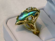 A gold ring set with an Abalone pearl.