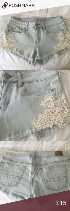 American eagle shorts size 4 Light wash with crochet detail American eagle shorts size 4. Frayed bottoms American Eagle Outfitters Shorts Jean Shorts