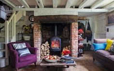 The living room: A jotul stove is the cottage's main source of heat