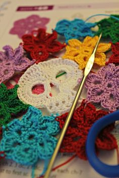 Cool crochet skull with flowers by Heather C. on Hookey :D Love these projects!
