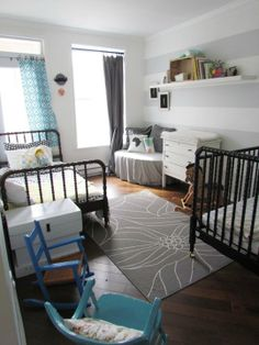 Crib painted in black, colours of the room are quite neutral, only some striking accents... Love it!