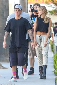 Fully clothed: Justin was covered up this time in cargo shorts and a large T-shirt...