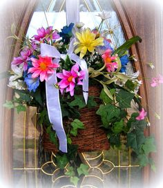 Spring colors, Pink, lavender,blues, yellows and whites.....so pretty....also comes with ribbon to hang with.....$26.99  http://www.primitivehomedecorandmore.com/index.html