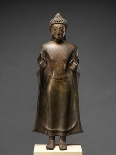 Standing Buddha, 8th–9th century Thailand (Nakhon Pathom Province), Mon-Dvaravati period Bronze with traces of gilt; H. 27 in. (68.6 cm); W. 10 1/4 in. (26 cm); D. 5 3/8 in. (13.7 cm) The Metropolitan Museum of Art, New York, Fletcher Fund, 1959 (59.149) http://www.metmuseum.org/Collections/search-the-collections/38954