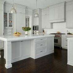 Light Gray Painted Kitchen Cabinets with Glossy White Chevron Tiles