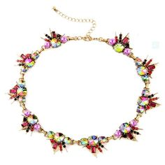 Our MIMI statement necklace is smart, sassy, and features iridescent multi-colored crystal gems in antique gold triangle setting. Necklace measures 40cm in length and features a lobster clasp. **All items are lead and nickel free.**