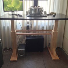 I really wanted a geek desk, but they're like 1,000 dollars. So I built my own for about 200 bucks (not including top). This is simply a regular desk that can rise up with a push of a button and turn into a standing desk. It takes about one minute to raise, speedier linear actuators are expensive.