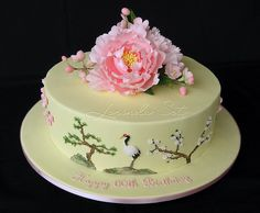 https://flic.kr/p/75iNzE | Peonies and Cranes | Side of this birthday cake depicts Chinese symbols of longevity - cranes, pine trees atop mossy rocks and plum blossoms.