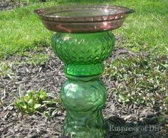 Glassware Totem Bird Bath. Upside down vase with a pie pan on top makes a great homemade bird bath or feeder.  Use E6000 to glue glassware together if its going to be outside.