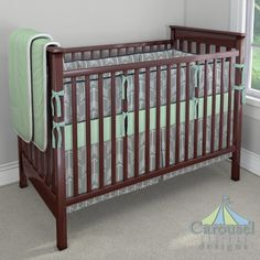 Crib bedding in Gray Arrow, Solid Mint, Mint Herringbone, Solid Navy. Created using the Nursery Designer® by Carousel Designs where you mix and match from hundreds of fabrics to create your own unique baby bedding. #carouseldesigns