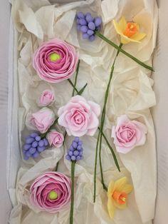 Gumpaste Ranunculas, Grape Hyacinth, Daffodils, Roses and buds.
