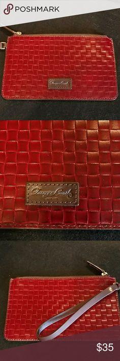 "Dooney & Bourke Leather Wristlet NWOT. Beautiful burgundy wristlet, basket weave design.8.5"" wide and 5"" high. Dooney & Bourke Bags Clutches & Wristlets"
