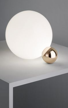 Perfectly balanced, the Flos Copycat Table Lamp, designed by Michael Anastassiades, consists of 2 touching spheres and omits a soft diffused light.