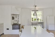 Scandinavian.  White interior.  White kitchen.