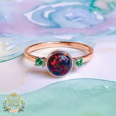 Gorgeous Black Fire, Ice White Opal or Baby Blue Opal showing lots of fire and colour change with stunning Emerald side stones in Fine Silver settings with solid gold ring band. There are two small prongs 999 Fine Silver settings on each side of the main stone setting with Emeralds. The ring in the main picture is the 9ct Rose Gold ring band with a Black Fire Opal. Ice White Opals can also be seen in the pictures. Please pick your preferred colour Opal from the drop-down menu. The main Opal… Rose Gold Band Ring, Gold Ring, Gold And Silver Rings, Black Rings, White Opal, Black Opal, Opal Wedding Ring Set, Black Fire, Emeralds