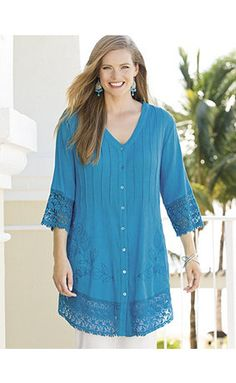 Romantic, delicately detailed tunic in airy crinkled cotton gauze. Rows of pintucking descend from the banded V-neckline in front and at center back; a ge