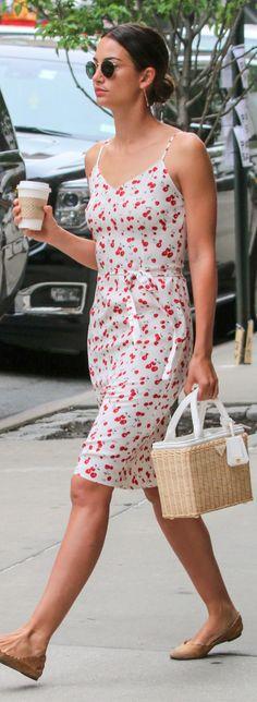 Who made Lily Aldridge's white cherry print dress, tan scallop ballet flats, round sunglasses, and straw handbag?