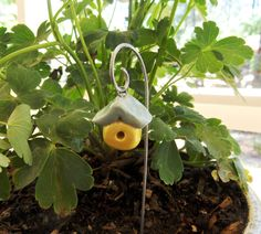 Handmade Clay Miniature Bird House on Wire Hook - I can make something like this with polymer clay.  Come to think of it, I can make a lot of faerie garden accessories out of polymer clay.  Hhmmm.