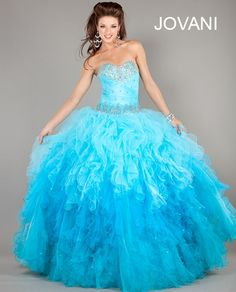 Gorgeous Jovani blue/ombre cinderela prom dress 2013 with a sexy ribbon lace up corset top, with beading tiered embellished tulle ruffle skirt. #promdresses #prom2013 #jovani