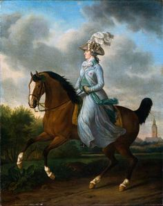 Princess Wilhelmina of Prussia (1751-1820) was the wife of Stadholder William V. They were married in 1767 when Wilhelmina was sixteen and William nineteen. This portrait was painted twenty-two years later, in 1789 as a present to William V from their two oldest children, Louise and William Frederick. It is an unusual portrait in that the princess is not riding side-saddle (with both legs on one side of the horse), the usual pose for a woman. She is sitting astride the horse as a man would…