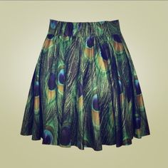 Stretchy peacock skater skirt Super cute pattern, very bright and vibrant! A soft, silly material with a nice flow. Extremely stretchy, so one size fits a s-xl. Will model if you ask me to, just let me know! Worn twice. Check out my other listings, ask me about my prices and bundle!  Have a gnarly day, dudes! Skirts Circle & Skater