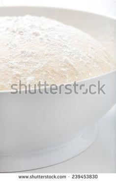 fresh, handmade pizza or bread dough in a white bowl - stock photo