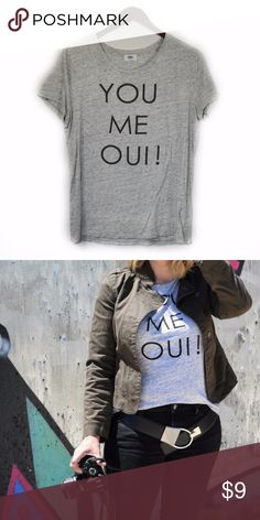 """You Me Oui! Old Navy Graphic Tee When in doubt, say it in French. This graphic tee in heather gray will look great styled with your favorite jacket this fall!  Brand: Old Navy Size: Large Color: Gray Bust: 40"""" Length: 25"""" Fabric: 60% cotton, 40% modal Imported Excellent Used Condition  Reasonable Offers Welcome! Bundle and Save on Shipping! Old Navy Tops Tees - Short Sleeve"""
