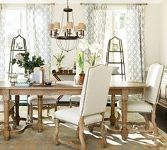 This all white dining room feels open and airy and incredible inviting!