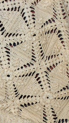 Off white crocheted bedspread.