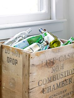 A Budget-Friendly Kitchen Makeover-Even recycling bins deserve a little soul. Why live with an unattractive plastic trash can when a crate brings character to the task?    Read more: Cheap Decorating Ideas - Kitchen Makeovers - Country Living