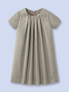 Jacadi Girls Alicante Dress. Imitation ivory nut buttons, pleats to add volume. 2% Spandex - 49% Polyester - 49% Viscose, lined in cotton voile lined for comfort.                                                                                                                                                                                 Plus