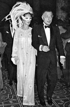 "{The Black & White Ball} Marella Agnelli (née Princess Caracciolo) accompanied by her husband, Gianni Agnelli, at the ""Black and White Ball"" legendary masked ball organized by the Writer/American author Truman Capote in Grand Ballroom of New York City's Plaza Hotel. NY, November 28, 1966.    -Marella is wearing a Creation of Frederico Forquet."