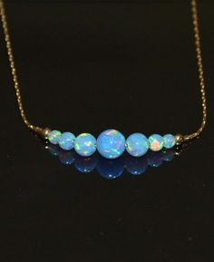 Hey, I found this really awesome Etsy listing at https://www.etsy.com/listing/207982889/blue-opal-necklace-tiny-opal-dot