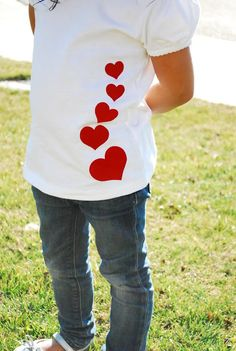 To make this heart shirt, use flocked t-shirt vinyl from Expressions Vinyl. It's so incredibly easy to work with. All you do is cut out your design and iron it on. Once it has cooled you peel off the top layer, sit back and enjoy your work. Valentine Shirts, Valentines Diy, Vinyl Shirts, Kids Shirts, T Shirts For Women, Sewing Shirts, Heart Shirt, Valentine's Day Diy, Personalized T Shirts