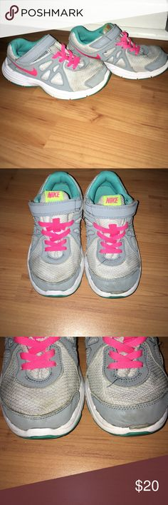 Girls Nike sneakers size 13 Nike revolution 2. Gray, pink, white and teal. Some wear and rare lots of life left. Rubber little part missing in front as seen in photos. Some stains as well. Freshly washed and cleaned. No having to tie shoes for your little one easy Velcro strap. Easy on and off too!! Nike Shoes Sneakers