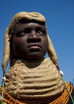 Mumuilas tribe girl with her necklace - Angola by Eric Lafforgue, via Flickr