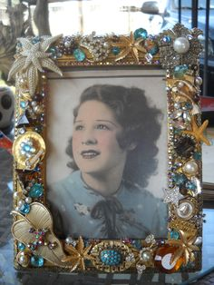My mother, Belinda Torres in a frame I made with some of her vintage jewelry