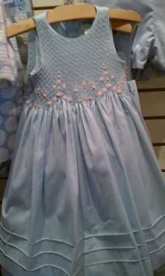 Blue dress with pink rosebuds. The tucked hem adds so much to this dress.