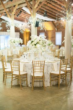 Elegant gold and white wedding table decor: http://www.stylemepretty.com/2017/04/07/modern-jane-austen-style-wedding/ Photography: Nancy Ray - http://nancyrayphotography.com/