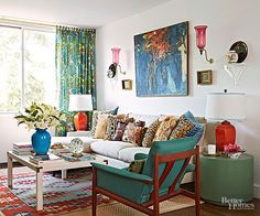 One part traditional, one part modern, and one part vintage, this living room reads as a well-organized design thanks to patterned textiles that draw on a shared palette of blue, green, orange, and red. The striking scheme, pulled from an abstract artwork above the sofa, repeats in different tones, textures, and motifs to boost the room's Boho-chic appeal./
