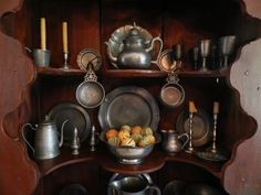 Some of my pewter..Love this hutch and her pewter collection!