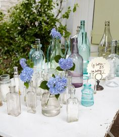 "Group similar objects together. A lone bottle is just a bottle, but a whole bunch of them reads like a photo in an Anthropologie catalog.  As for those bottles, Lane adds, ""Pop in a few hydrangeas, and suddenly you've suggested function, too."""