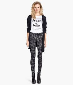 Black & white patterned leggings with slight sheen and elastic waist. | H&M Divided