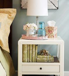 """Bedrooms are all about being comfortable. Work little creature comforts into your bedroom's design and you'll love the space even more. Assemble a """"care package"""" for your nightstand with lotion, tissues, a water decanter, and any other little comforts you might want bedside. Infuse your bedroom with a soothing scent as a final flourish./"""