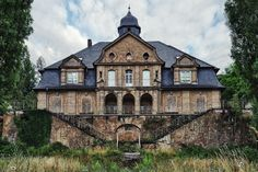 Abandoned orphanage in Germany. Love the dual stairways!
